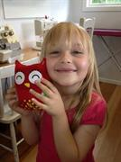 holding her owl made at the school holiday workshop at Frolic in Fabric