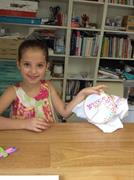 showing her running stitch made at the school holiday workshop at Frolic in Fabric